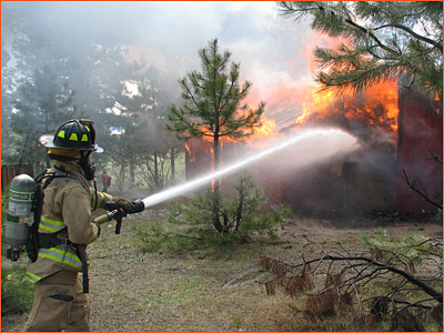 A volunteer fighting a fire